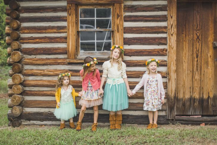 "The couple enlisted four of their friends' daughters to serve not as flower girls but as ""confetti girls."" The little ladies walked down the aisle with confetti-filled wands, wearing floral crowns and moccasins."