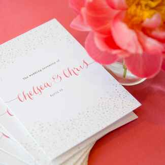Modern Pink and glitter program next to flower
