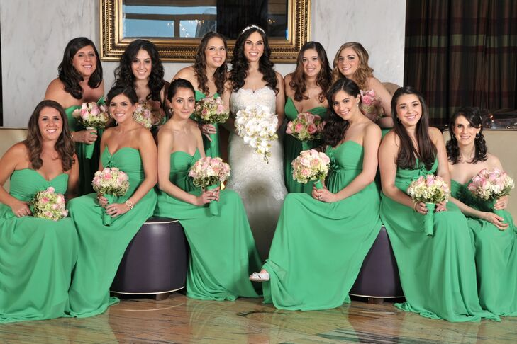 Rita's bridesmaids wore emerald-green strapless bridesmaid dresses and carried pink, green and white bouquets to match.