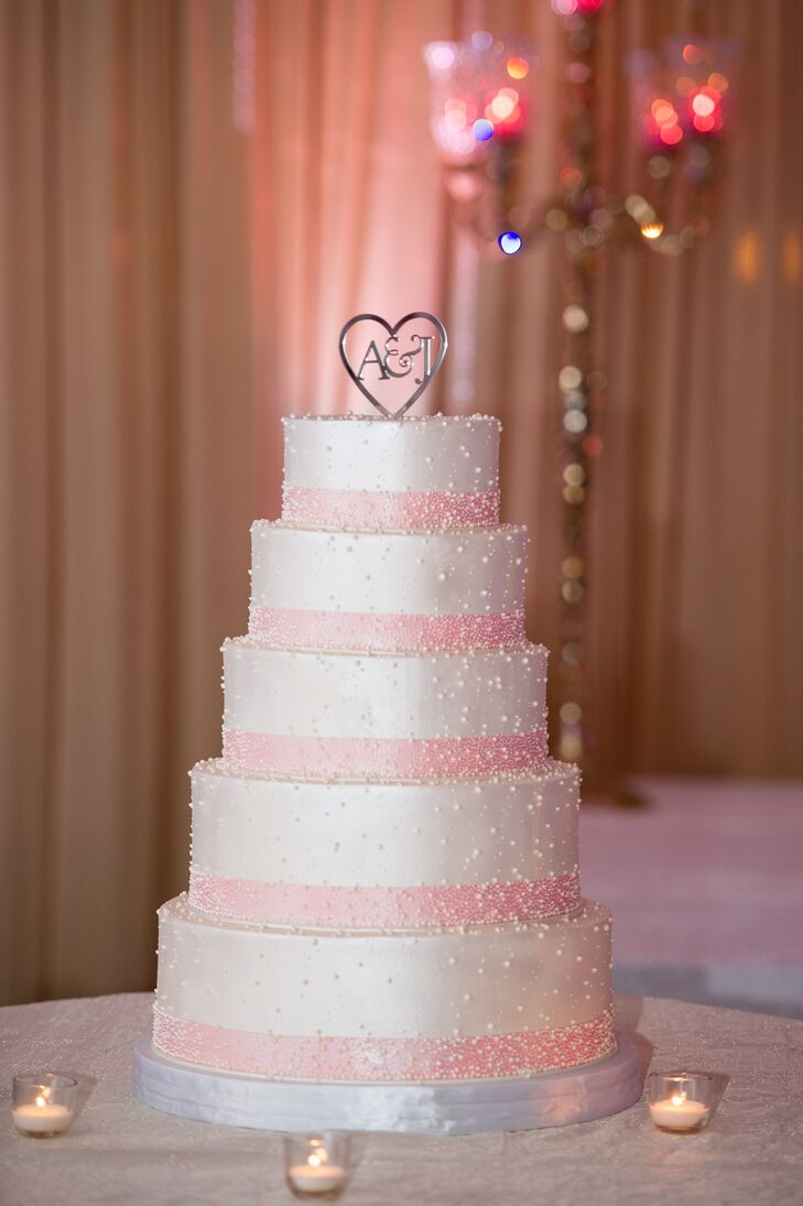 Pink and White Five-Tier Wedding Cake with Topper