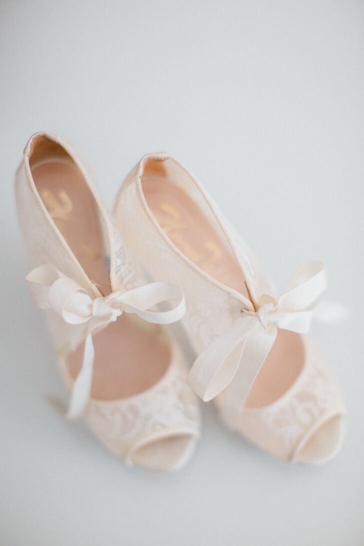 A pair of Harriet Wilde Chantilly lace bridal peep-toe bootees added a romantic, feminine touch.