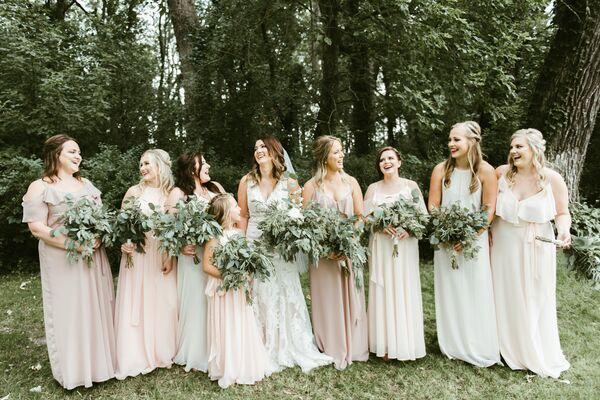 Chic Blush Bridesmaid Dresses At An Outdoor Wedding