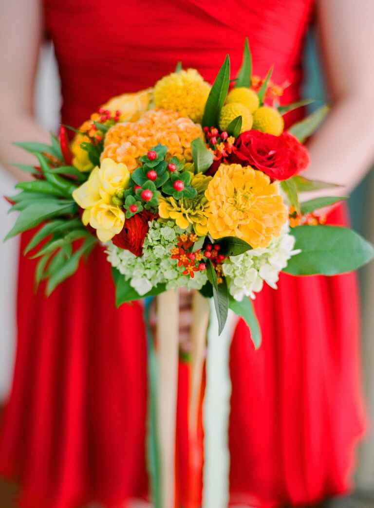 Yellow bridesmaid bouquet with red bridesmaid dress