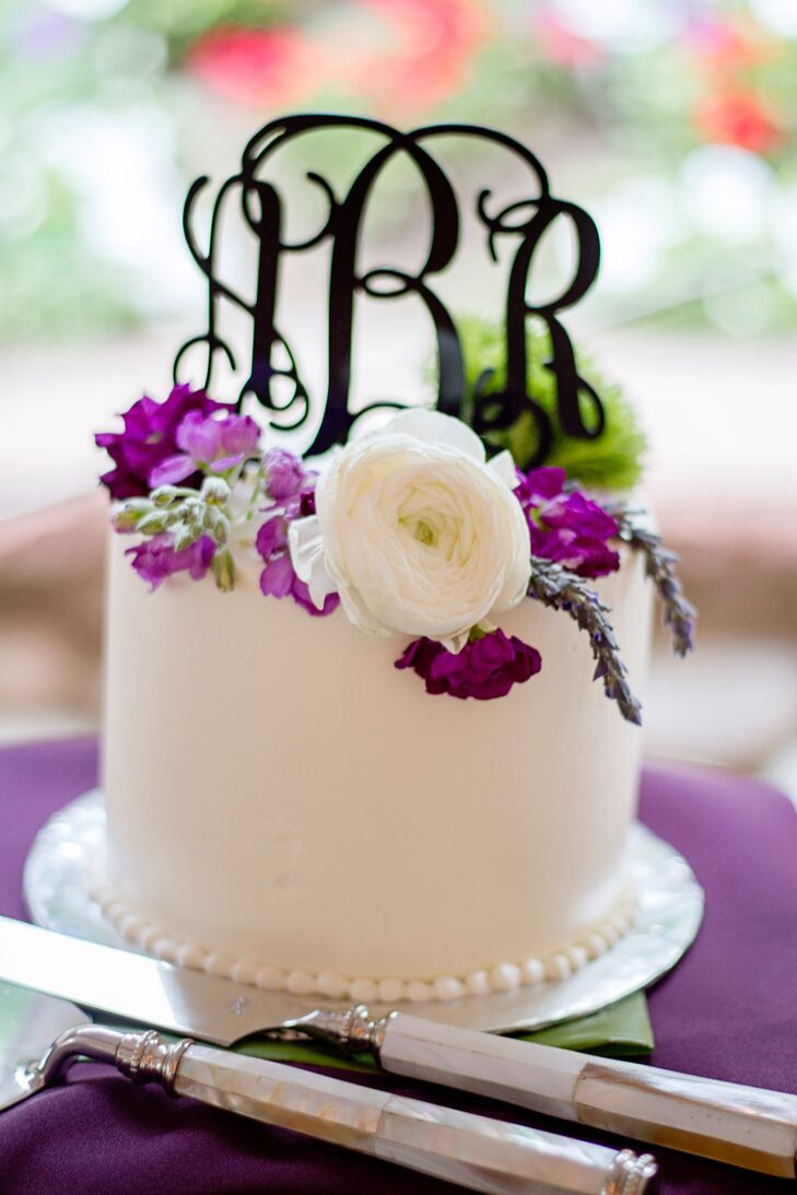 In lieu of one large cake, Ashley and Roshan served a number of smaller cakes. This way there was something for everyone. The couple had a small, white buttercream cake with a custom monogram topper for the cake cutting ceremony.