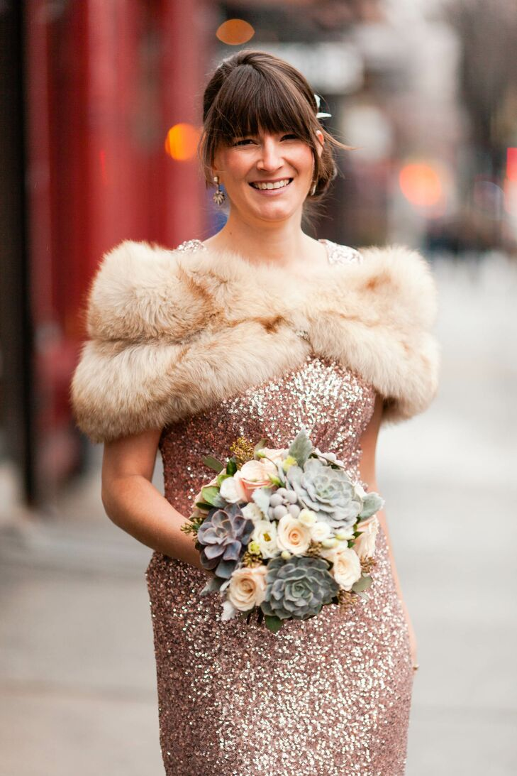 With an anything-but-average Badgley Mischka gown taking the place of a classic white dress, Beth knew her accessories had to be just as fabulous. Instead of a traditional veil, she added a feathery hairpiece to her classic updo and completed her look with a vintage fur wrap.