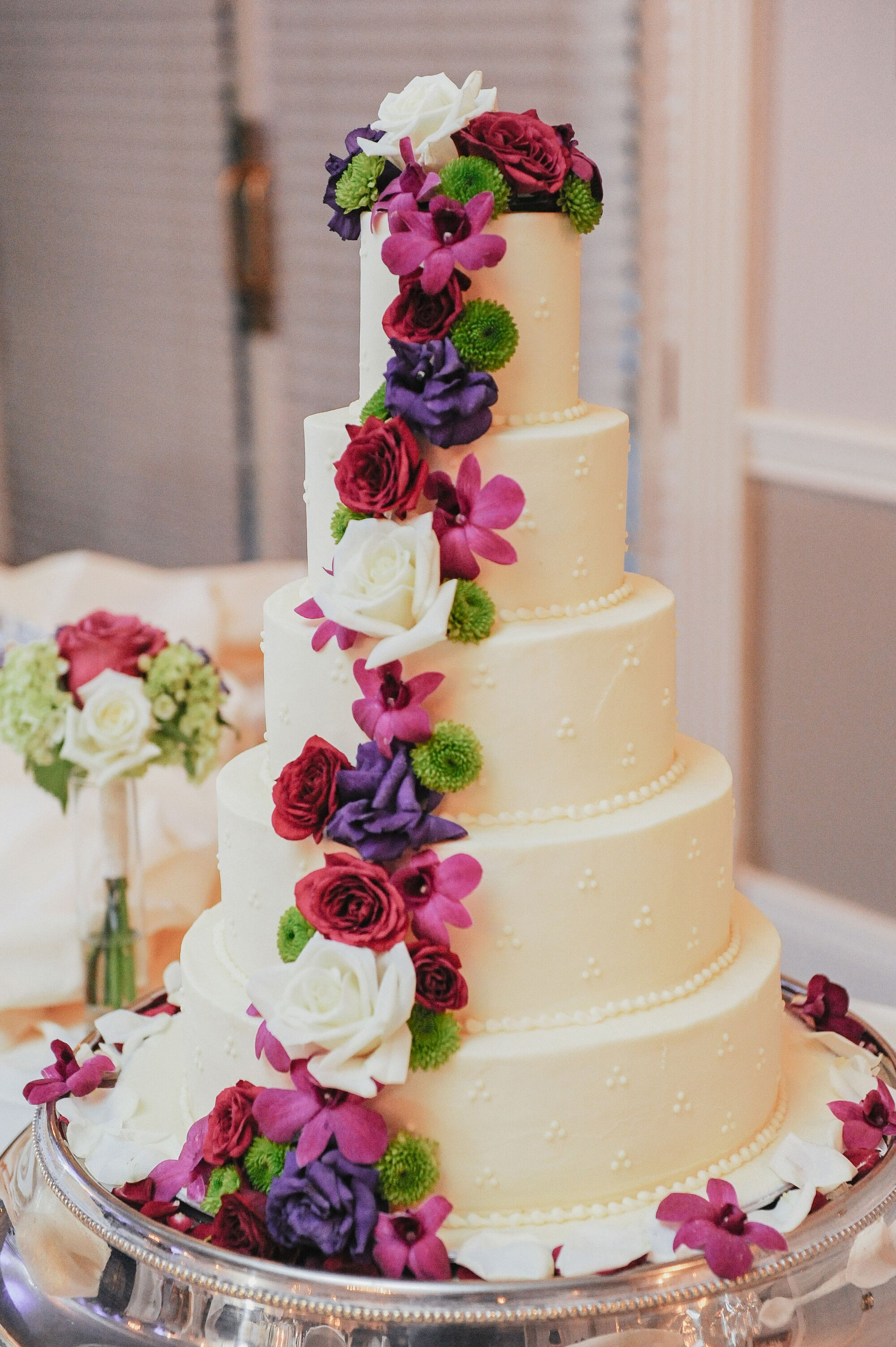 Tiered Ivory Wedding Cake Colorful Flowers