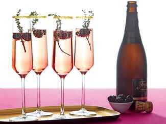 Blackberry champagne wedding cocktail with sugared rim