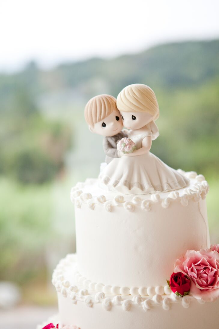 Kelley and Jeff chose a tiered, strawberry shortcake wedding cake covered in vanilla buttercream frosting. For the topper, they went with newlywed Precious Moments figurines that are sure to be a sweet keepsake.