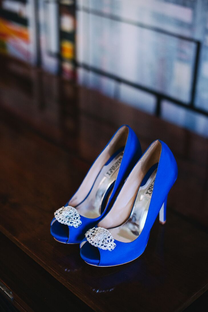 "The bride wore Badgley Mischka royal blue, peek-a-boo heels with an art deco embellishment for her ""something blue."""