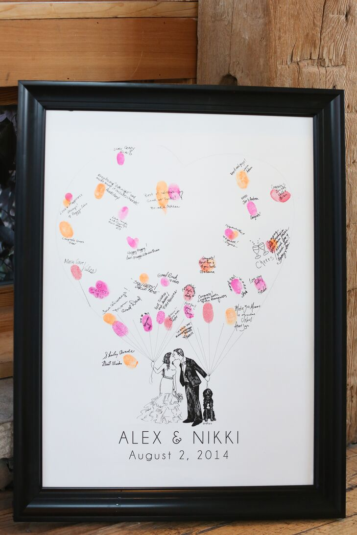 Guests left their fingerprints and well wishes on a custom sign-in board with an illustration of the couple and their dog Charlie. The fingerprints formed the outline of colorful bunches of balloons.