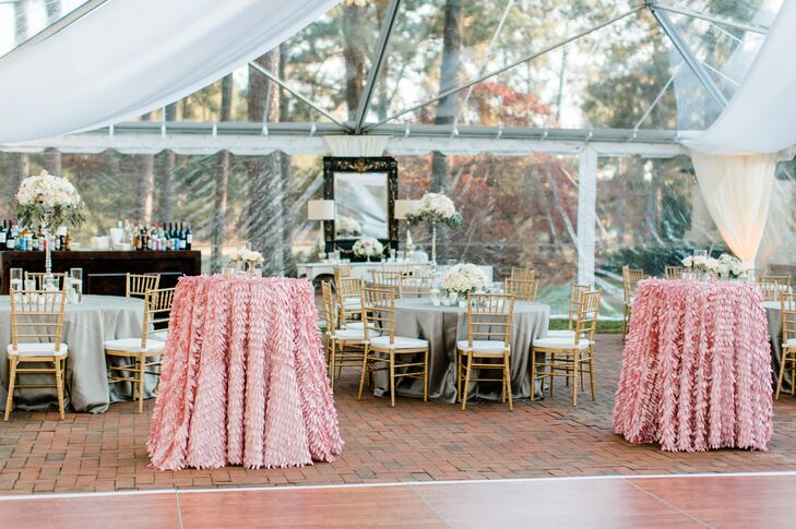 The clear tent was partially draped in fabric with amber colored up-lighting.