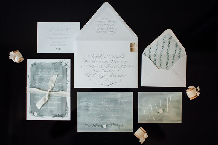 "For Lauren and Kent's watercolor-wash invitations perfectly matched the seaglass-colored bridesmaid dresses, and custom portraits of each member of the bridal party were created for the ceremony programs. ""I had so much fun with Annie Brooks of the Wells Makery in designing our custom wedding invitation and day-of paper goods,"" Lauren says. ""Her watercolor is so beautiful and so delicate and romantic. I loved how she added plenty of personalized details."""