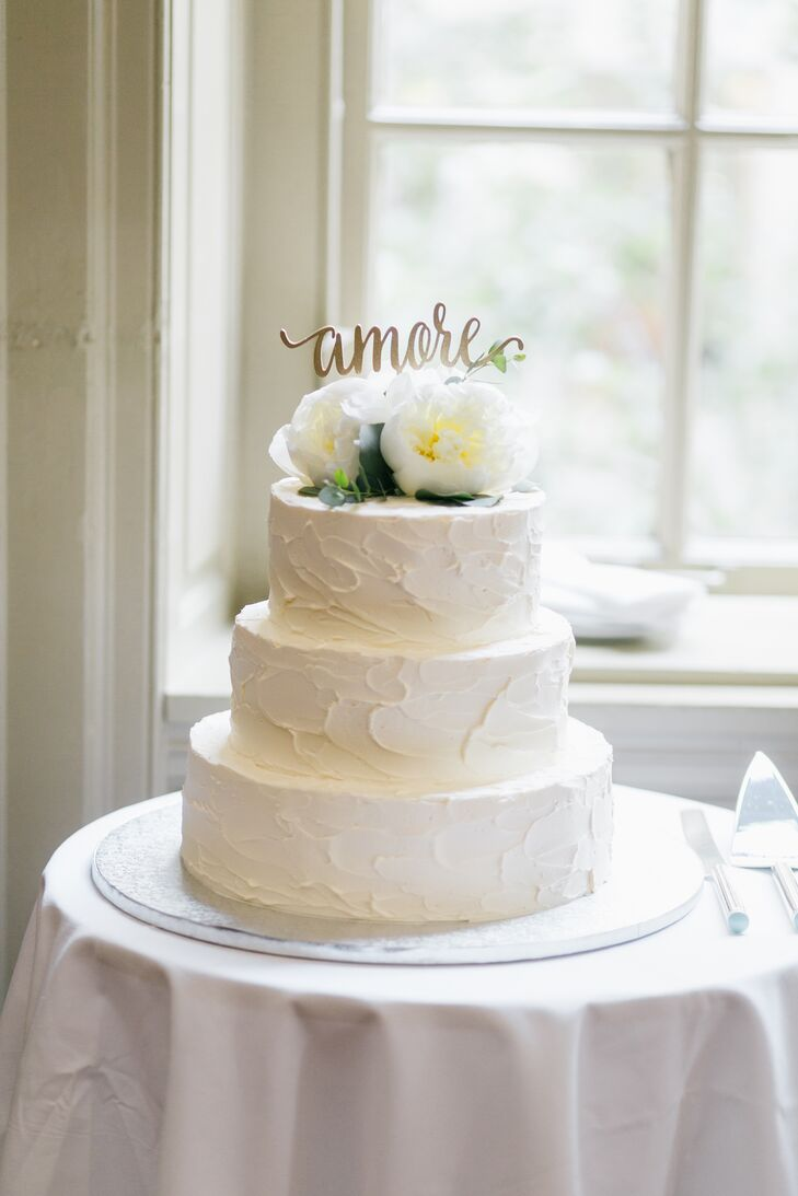 "The Funfetti cake with buttercream icing was decorated with a gold ""Amore"" cake topper and white peonies."