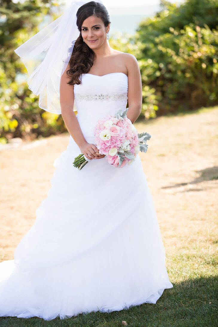 Bride In Strapless Ball Gown Wedding Dress With Mid Length Veil