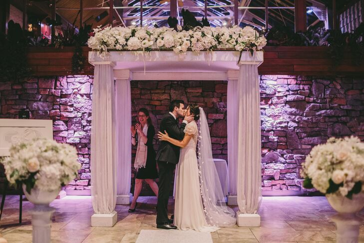 Stately Columned Chuppah with White Floral Garland