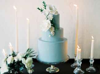Blue cake with large white flower