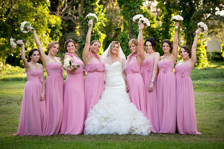 Wanting her bridesmaids to feel comfortable, Jacqueline asked them to choose pink bridesmaid dresses in any style of their choosing. Coincidentally, all chose floor-length dresses in the same two styles.