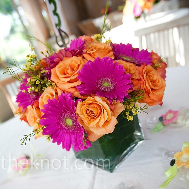 The Centerpieces Were Vibrant Combinations Of Hot Pink Gerbera Daisies Orange Roses And Yellow