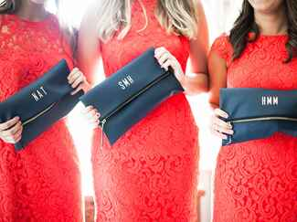 bridesmaid with monogrammed makeup bag