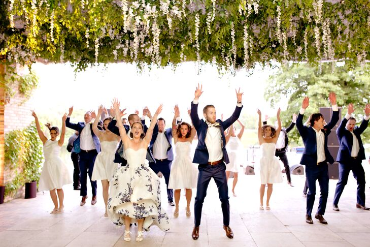 "Maggie and Joe made their grand entrance alongside their bridal party in a massive, choreographed dance to ""Uptown Funk"" by Mark Ronson and Bruno Mars."