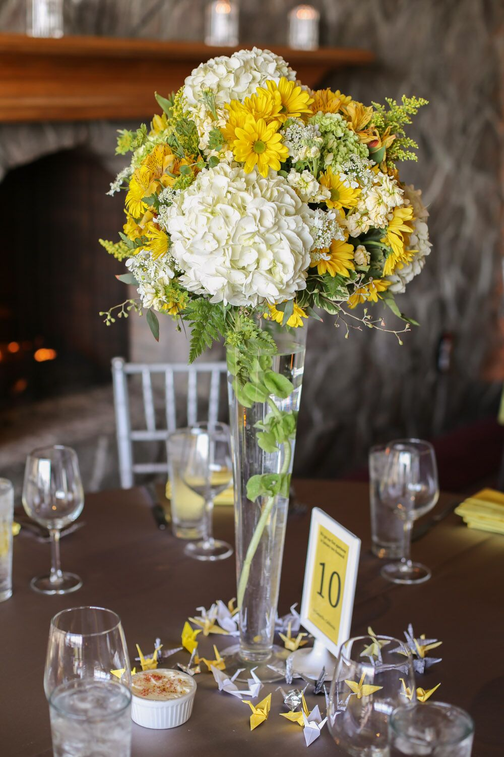Tall Yellow And White Centerpieces In Trumpet Vases