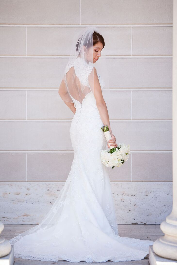 Patricia picked out an ivory lace Maggie Sottero that had a keyhole back and was accented with Swarovski crystals and a fishtail train. She wore her sheer veil and held her ivory bouquet of flowers.