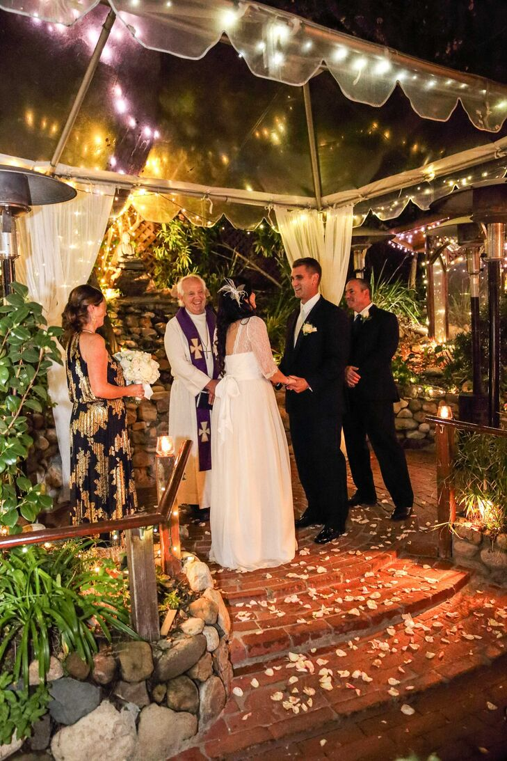 Lorenzia And Emanuel Were Married Underneath A Plastic Covered Gazebo D With White Linens