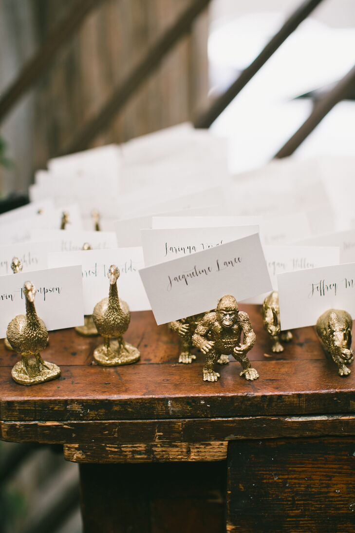 Hand-Lettered Escort Cards in Gold Animal Holders