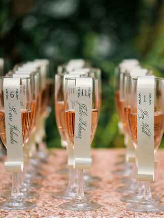Glasses of champagne as wedding escort cards