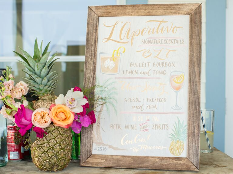 Tropical themed engagement party bar decor