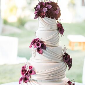 Purple wedding cakes classic ivory cake with draping and dramatic purple flowers junglespirit Choice Image