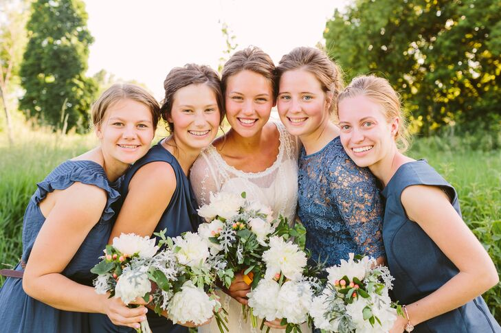 All the bridesmaids made sure to match with a blue color scheme, but in entirely different styles. One bridesmaid wore a lace, quarter-sleeve dress, while the others maintained a shorter sleeve without lace.