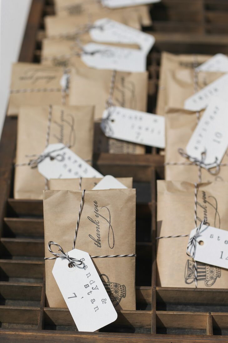 Elana and Jamie put together all the escort cards. Wrapped in brown paper and striped string, they resembled packages that had been sent in the mail. Each one had guests' names hand-stamped and a packet of Jamie's favorite Montana Gold Tea from Missoula Tea and Spice.