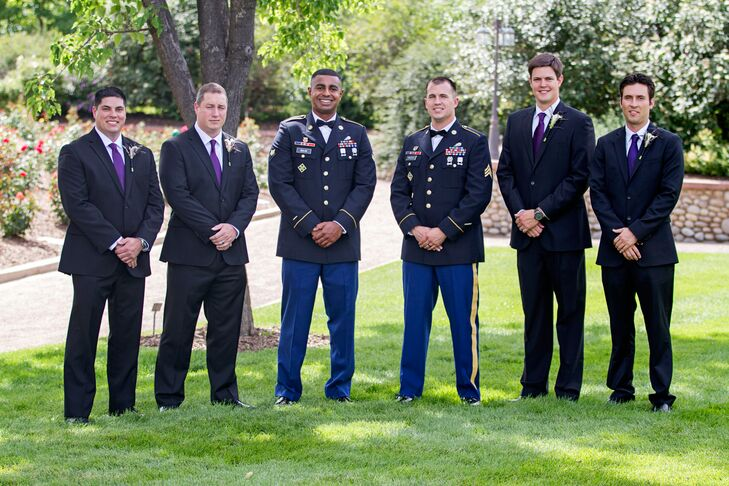 The groomsmen and ushers who are not active duty members of the military wore black suits with purple ties.