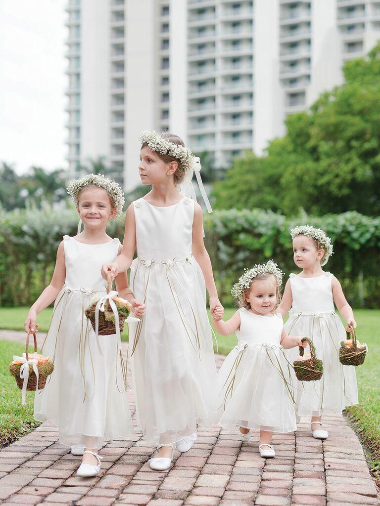 White flower crowns on flower girls