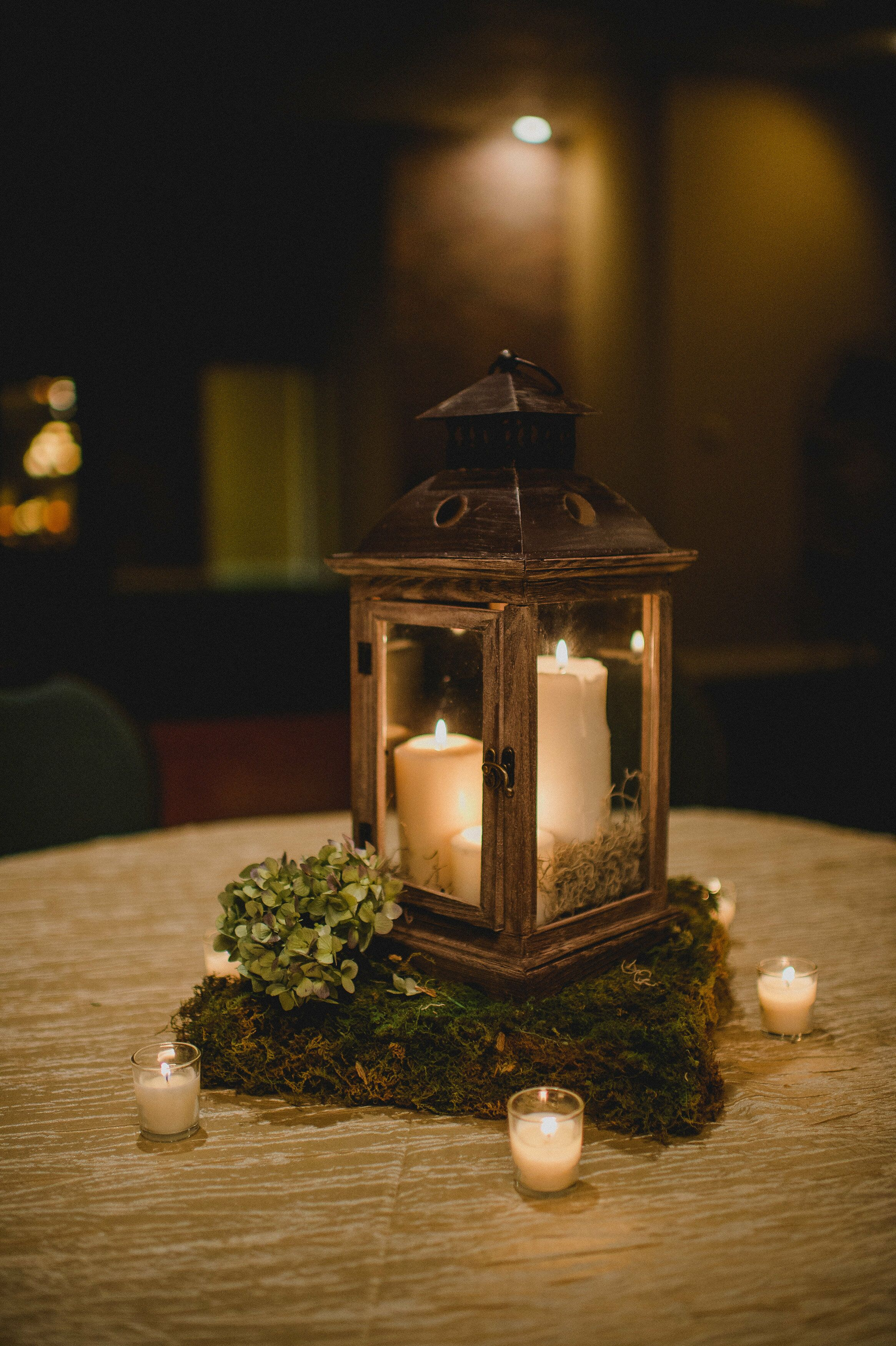 wooden lantern centerpiece with moss stand. Black Bedroom Furniture Sets. Home Design Ideas