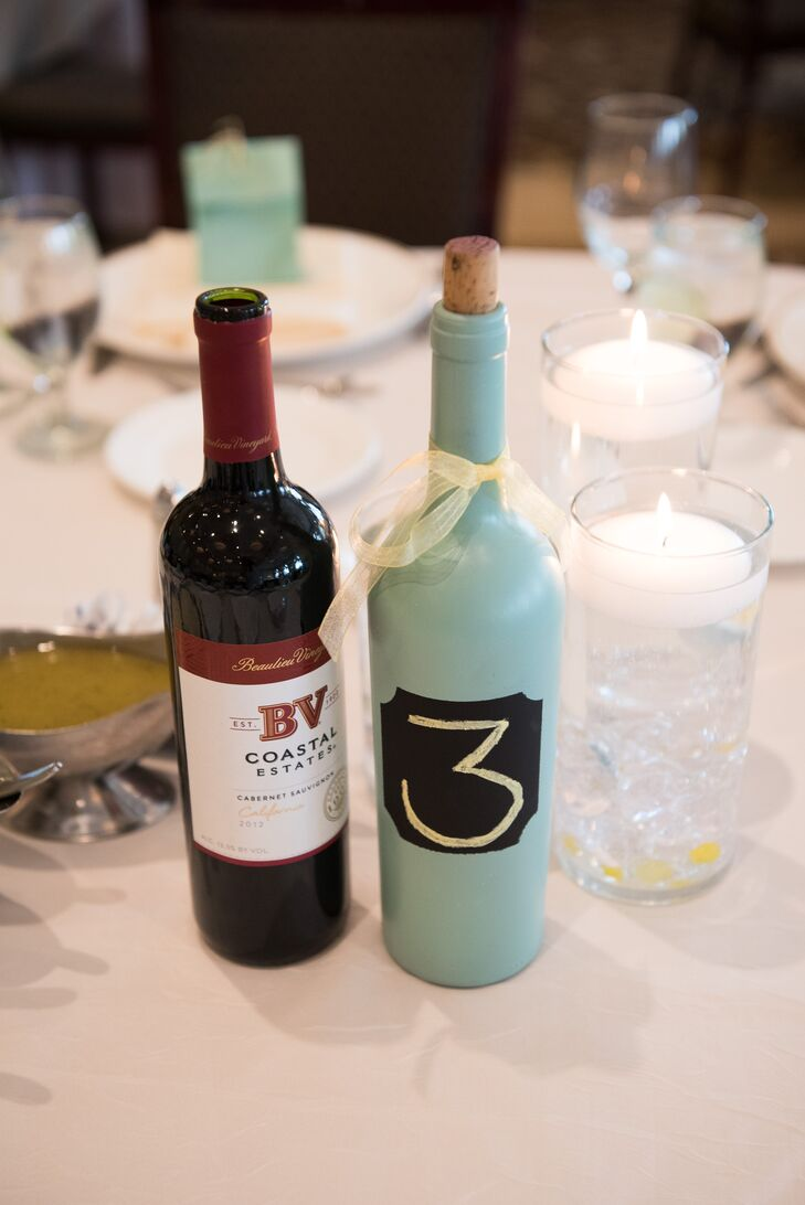 Painted mint wine bottles were used for the charming table numbers at Venuti's Ristorante & Banquet Hall in Addison, Illinois.