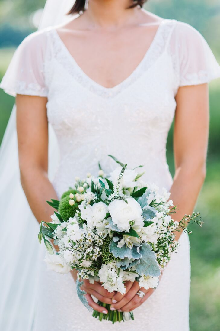 """We wanted to keep the look very loose, as if we had picked up a bunch of white wildflowers,"" the bride says of her Art Quest-crafted bouquet. Astilbe, sweet pea and lamb's ear were used for a soft, natural feel."