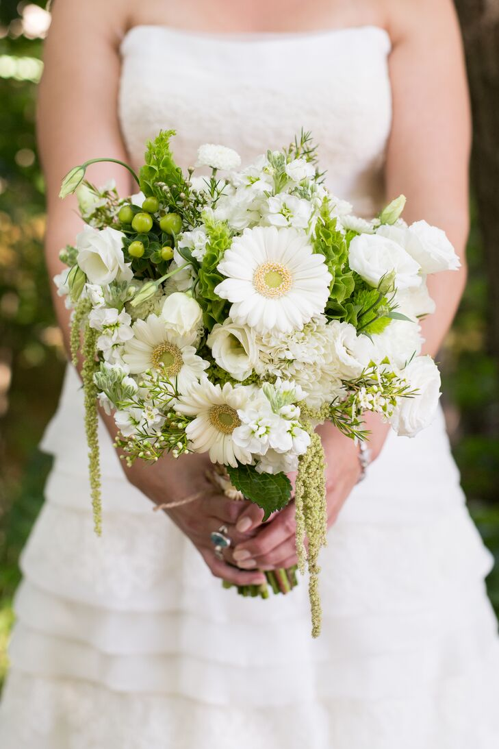 April carried a bouquet of white gerbera daisies, waxflowers, amaranthus, lisianthuses, mums and bells of Ireland.