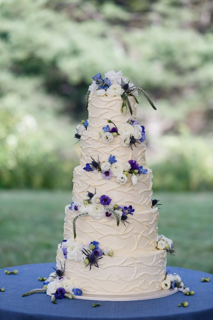 Decorative Buttercream Cake With White And Purple Flowers