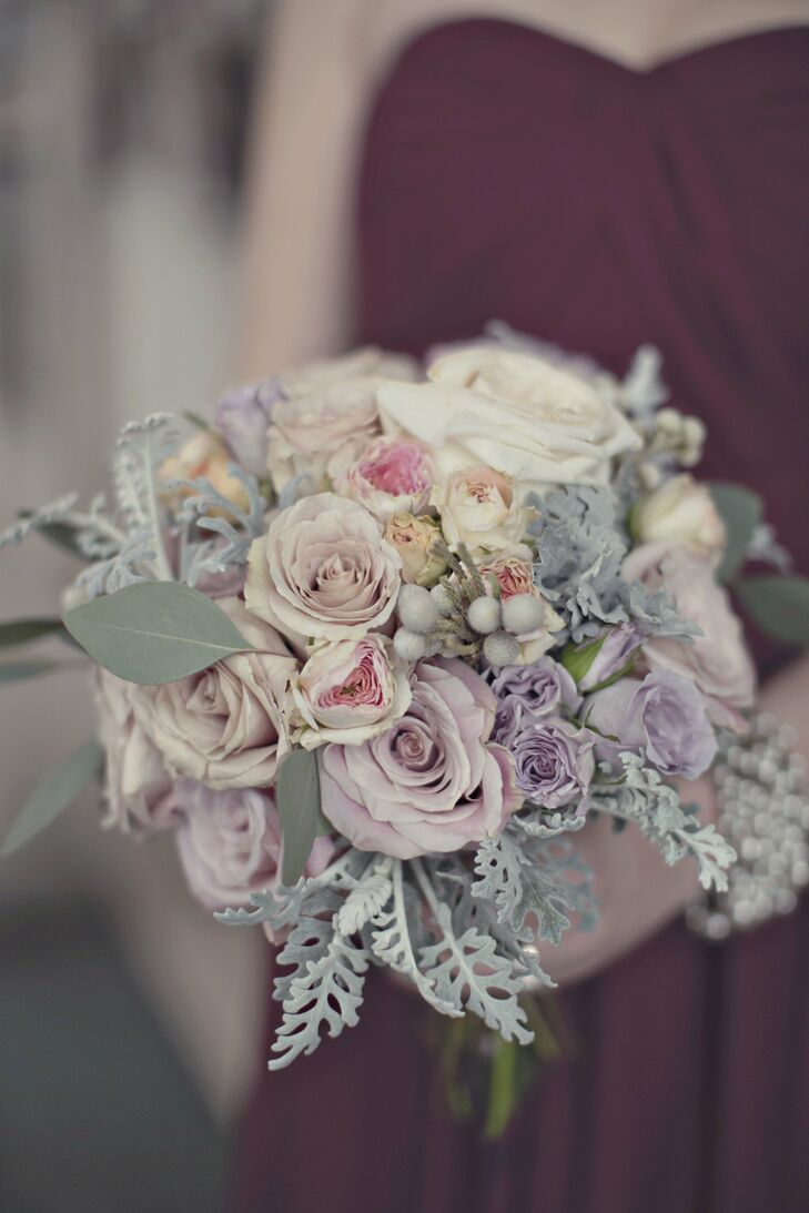 Romantic roses, brunia berries and eucalyptus leaves were combined to create the pastel bridesmaid bouquets.