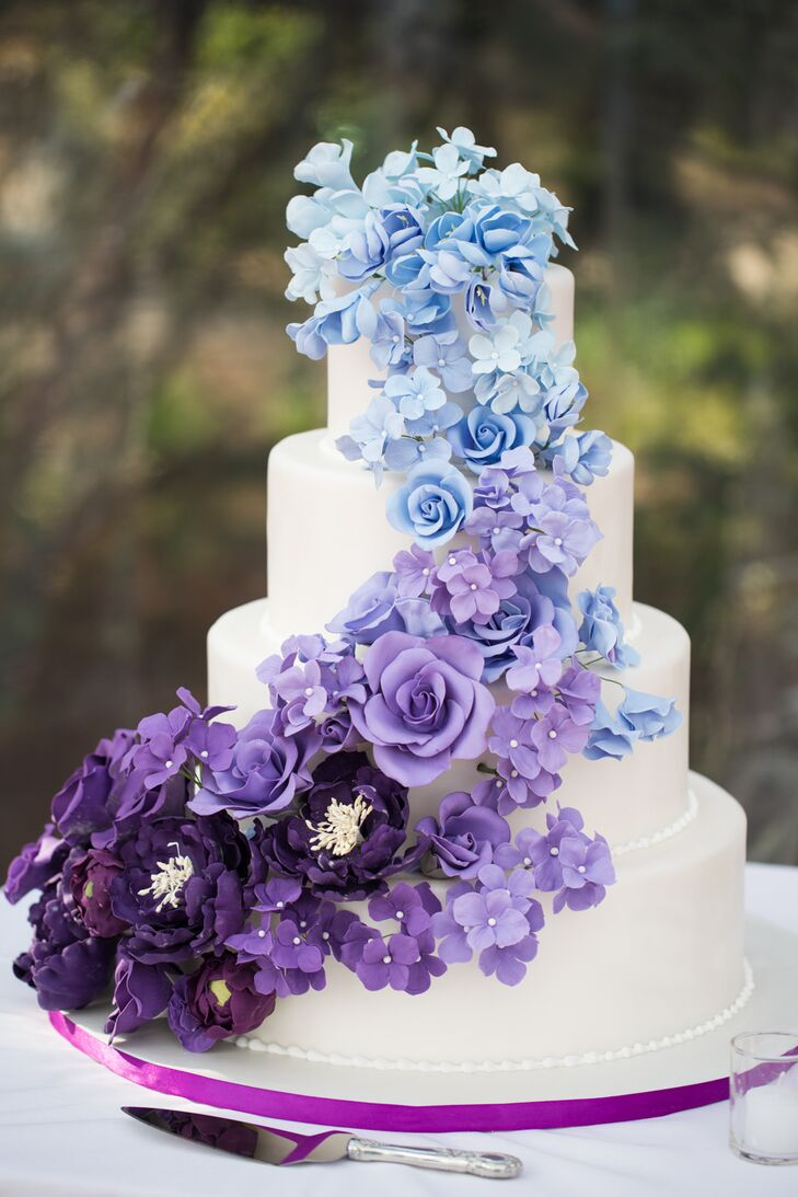 """Renowned cake baker Ana Parzych worked with us to design the most magnificent—and best tasting—cake our guests had ever seen, featuring handmade sugar flowers cascading down four tiers in an ombre theme of blues and purples,"" Lisa says. ""Each tier had a different flavor combination, and each guest had the chance to taste all three."""