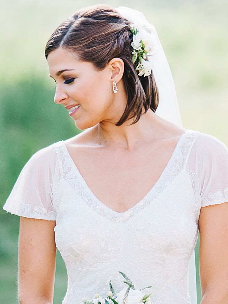 Short and sleek wedding hairstyle with a twisted braid