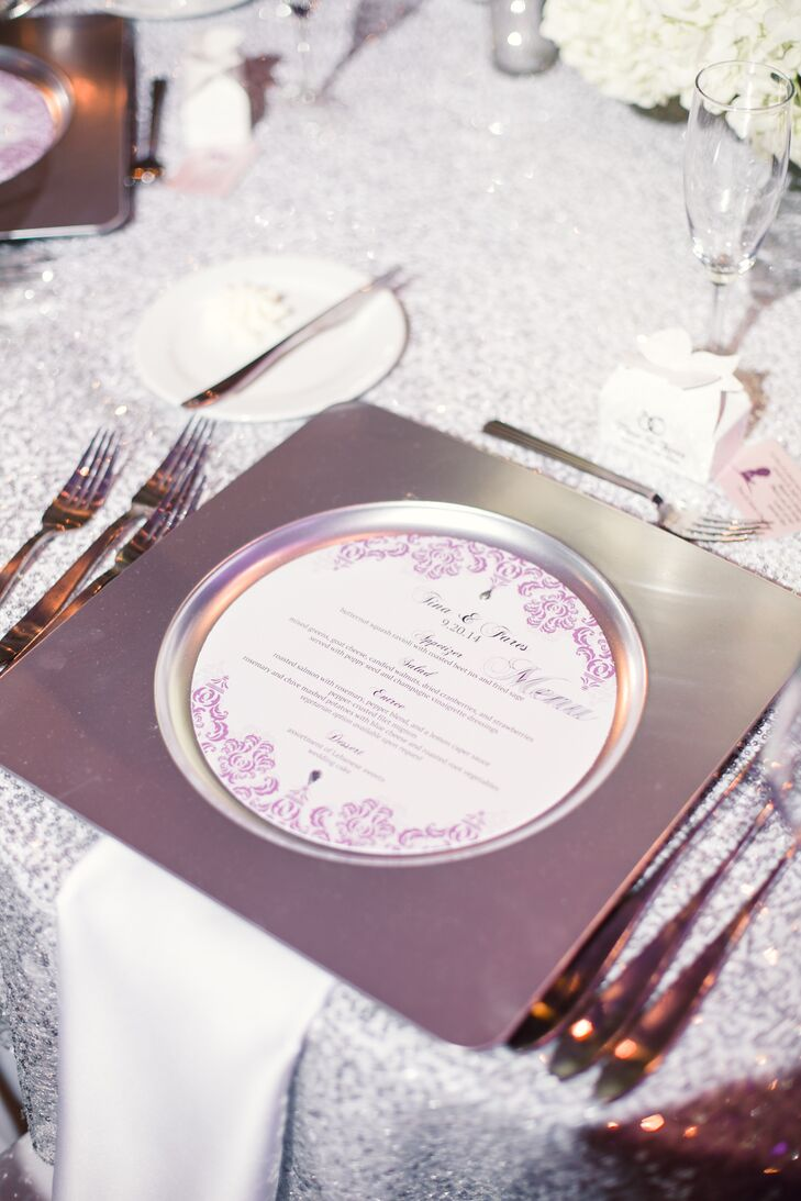 Tina and Fares's menus, seating chart and so on were designed by one of her bridesmaids. Each piece of stationery included the same purple, white and silver design.