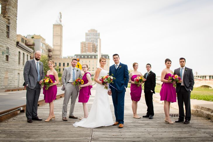 The bridesmaids wore fuchsia infinity dresses for the rustic, vintage wedding. Anna and Brandon loved how each woman could wear the dress however she wanted because of the style for a uniform but personalized look. Brandon chose a blue suit modeled after Jack White's style, and the groomsmen wore mix-and-match gray, charcoal or black suits.