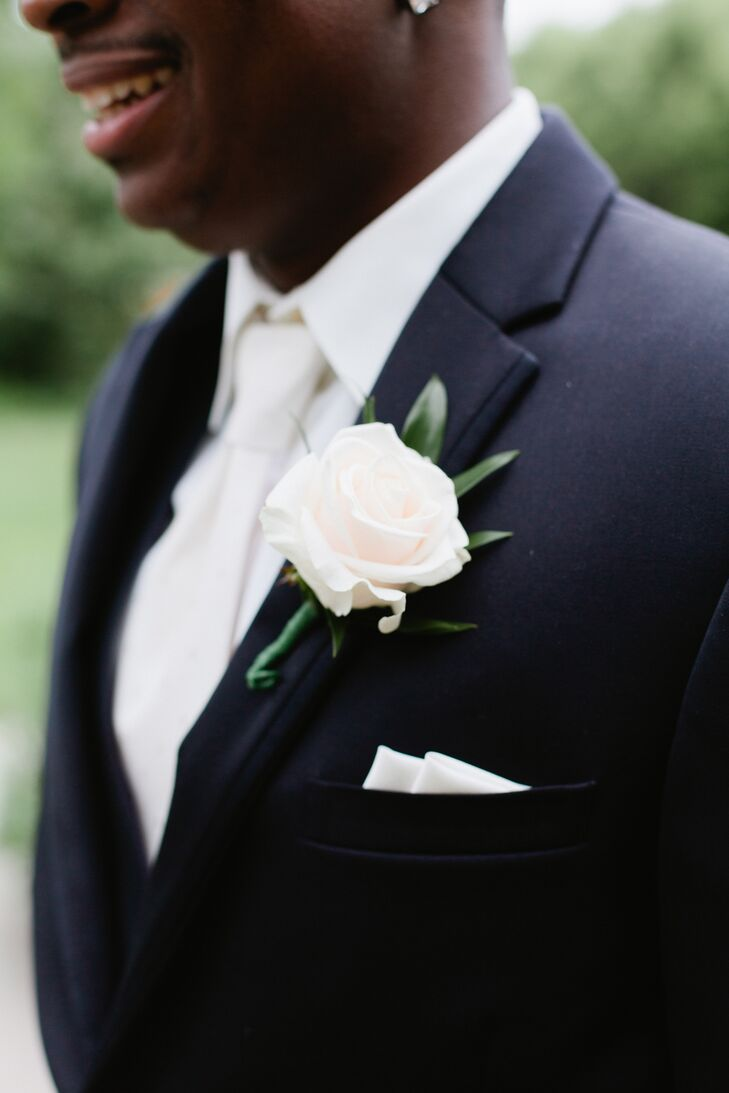 Willie wore a single rose bloom on his Michael Kors lapel. The groomsmen stood out with light pink roses while the groom wore a white one. The pink roses matched the colorful bridesmaid bouquets, and the white rose and tie matched Ali's bridal look.