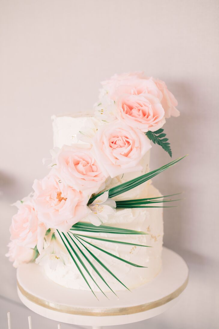 Two tier wedding cake with cascading roses junglespirit Choice Image