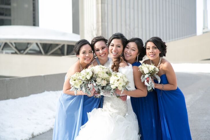 All three bridesmaids wore Dessy strapless, full-length dresses in light blue shades, while the maid of honor wore an Alfred Sung one-strap, full-length blue dress.