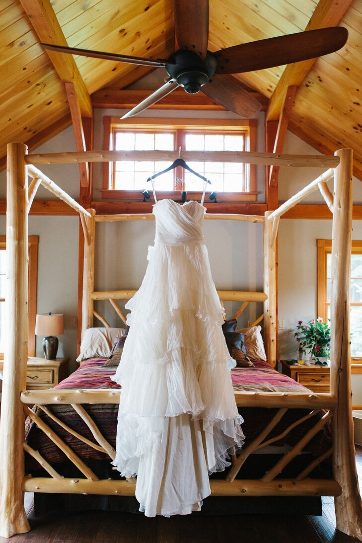"""Since our ceremony was on an island I knew I wanted something echo-chic,"" says Alissa. She worked with Lindee Daniel to design her layered, A-line wedding dress made out of sustainable materials."