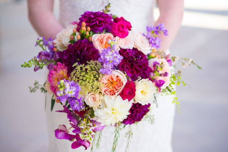 """I have always loved the rich colors of fall in the South, so when I began to plan our wedding, I knew  I wanted those colors to be our wedding colors,""  Emily says. She handpicked the flowers in her bouquet, with garden roses, dahlias, ranunculus and stock as the central flowers."